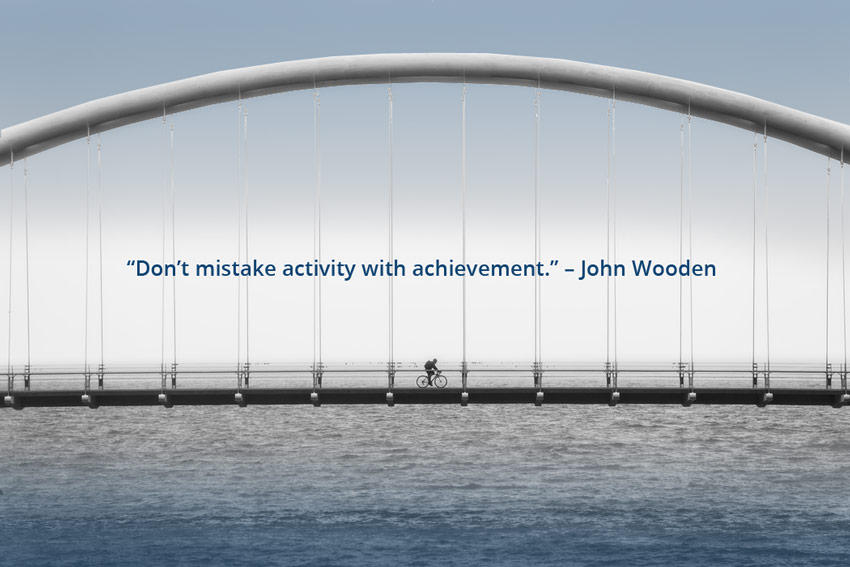 Dont-mistake activity with achievement, John Wooden Quote
